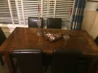 £60 Dark Wood Table and 6 leather chairs