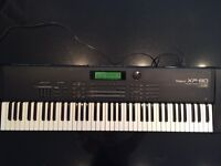 Roland XP80 with flight case and manual