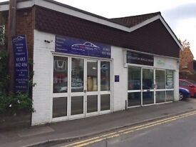 Car repair/workshop to rent on busy road one mile from Guildford. Established use.