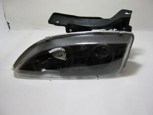 95-99 Chevy Cavalier Headlight chome with projector LH, RH 714