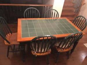 Dining Table Solid Wood with Tile Top and six chairs.