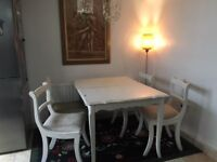 Laura Ashley, dining table with 4 chairs.