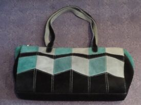 Stunning real leather handbag in navy, teal and pale blue geometric design