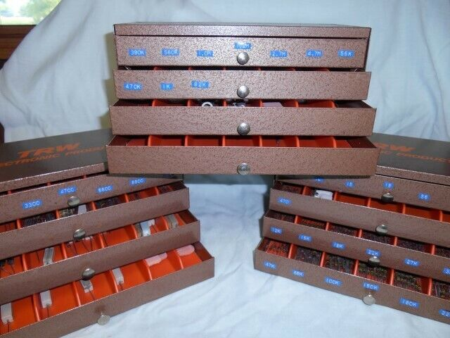 Huge Bargain brand new TRW resistors of various values in easy drew cabinets.