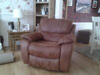 Rocking recliner armchair in brown faux suede