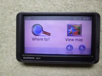 Garmin Nuvi 205W Sat Nav with manual, suction cup mount, cradle, power cable, and original box