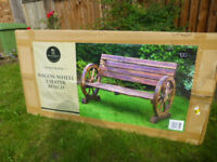 **FOR SALE** Unopened unused never assembled, boxed wagon wheel bench.
