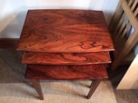 Nest of three rosewood side tables