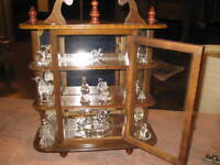 Curio Cabinet with 12 cyrstal figurines.