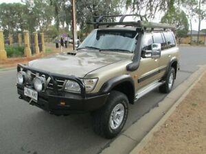 2003 Nissan Patrol GU III ST Wagon 7st 4dr Man 5sp 4x4 3.0DT Gold Manual Wagon
