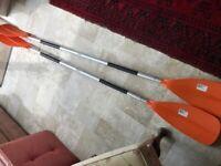 2 Orange Kayak paddles Aluminium rods. 215cm and 225 cm. Used Once.