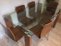 Glass topped dining table with 6 chairs originally purchased from 'Dwell'