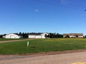 Montrose PEI home with three large shops and attached garage.