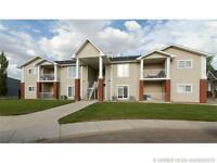 MOVE IN READY 2 BED TOWNHOUSE CONDO  OFF BROADWAY IN REDCLIFF!