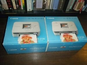 2 Cannon Selphy printers with photo paper for sale parts/repair