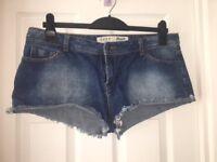 """""""Daisy Duke"""" style denim shorts"""