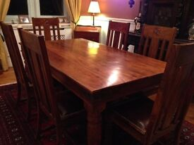 Dining Room table and six leather upholstered chairs in Sheesham Wood