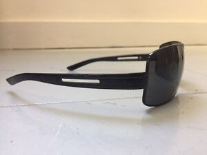 PRADA Sunglasses.  In Mint condition with case.