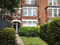 three double bedroom flat with back garden and facing Clapham Common available early July