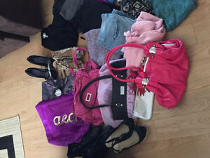 2 bags full of women's clothes purses and shoes!