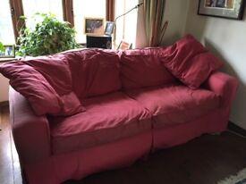 Red canvas sofa- Good condition except split seam needs mending