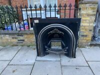 Matching pair of cast iron fireplaces