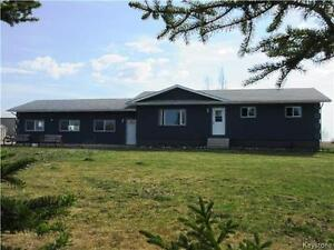 Price change for spacious 3BR home with outbuildings in Rossburn