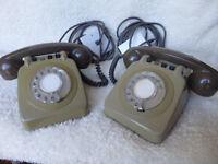 Pair of retro style BT 710 telephones.