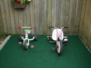 2 girls tricycle