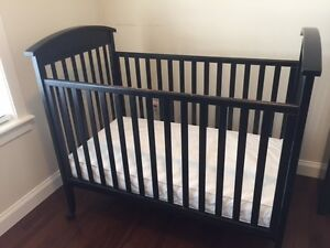 "Black Caramia ""Adrian"" crib and matching change table"