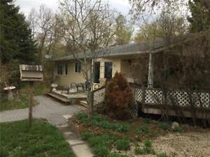 1/4 section with house/garage near Riding Mountain National Park
