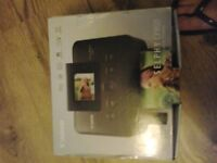 Canon selphy cp800 compact photo printer still boxed all leads but needs a new ink cartridge