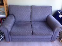 Two matching two seater sofas, different patterns - great condition