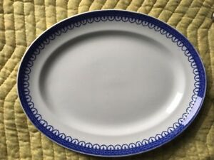 Antique white serving platter with blue trim
