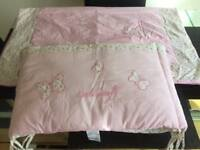 A Laura Ashley Pink Butterfly Cot Bumper and Duvet set