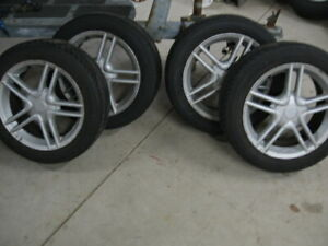 """SET OF 4 16"""" ALUMINUM RIMS AND EXC 195/55R16 TIRES.$200 FOR ALL"""