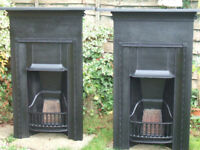 A PAIR OF RECLAIMED CAST IRON FIRE PLACES