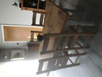 Solid wood farmhouse table and 4 chairs. Lovely. Painted legs, oiled top