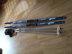 Cross country skis, poles and boots - woman