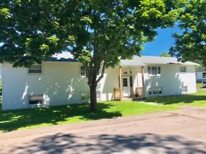 2 bedroom unit, NEWLY  RENOVATED with wood floors. July 1