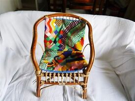 Vintage child's cane chair with arms and 1970s Bauhaus Liberty fabric seat squab