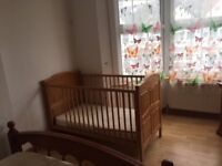 Used wooden frame baby cot
