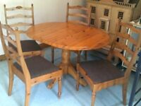 Pine Oval Table & four Pine Chairs .