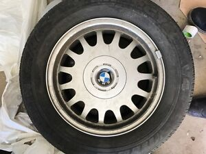 SET OF 4 BMW TIRES AND RIMS. DECENT CONDITION