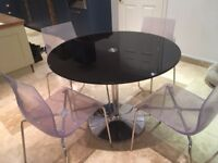 John Lewis black glass round dinning table and 4 clear acrylic chairs