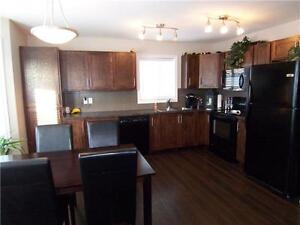 4 bedroom house with RV parking large back yard next to park