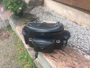 Black travel bag fits all motorcycles