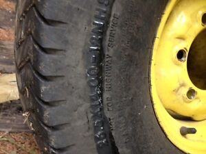 Two 26.5 x 14 x 12NHS Turf Tires on John Deere Rims for Sale