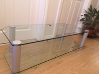 High quality clear glass low level large tv stand. Excellent condition,