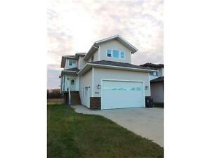 LOCATED IN SEXSMITH, LOW COUNTY TAXES AND PRICED TO SELL!